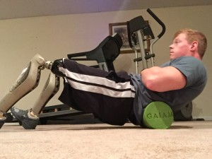 Lower back foam rolling performed with prosthetics on
